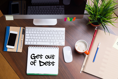 get out: Business Workplace with Get Out Of Debt Concept Stock Photo