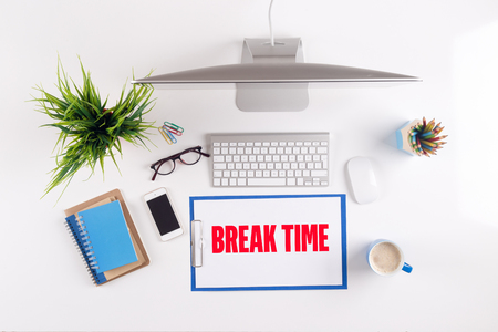 over worked: Office desk with BREAK TIME paperwork and other objects around, top view Stock Photo