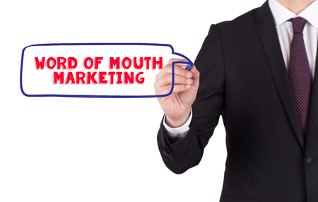 word of mouth: Hand writing a word WORD OF MOUTH MARKETING on white board Stock Photo