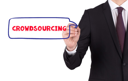crowdsourcing: Hand writing a word CROWDSOURCING on white board