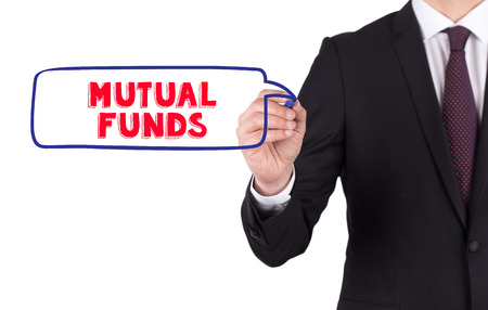 mutual: Hand writing a word MUTUAL FUNDS on white board
