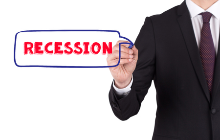unemployment rate: Hand writing a word RECESSION on white board Stock Photo