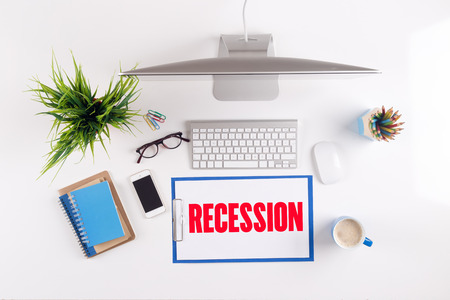 unemployment rate: Office desk with RECESSION paperwork and other objects around, top view