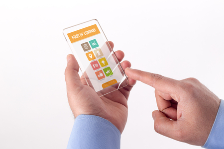 reasons: Hand Holding Transparent Smartphone with Start up Company screen Stock Photo