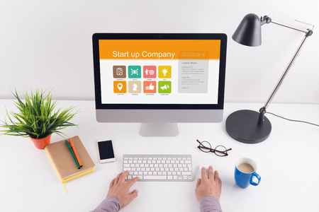 reasons: Start up Company screen on the workplace Stock Photo