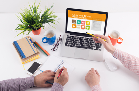 corporate social: Business desk concept - Corporate Social Responsibility