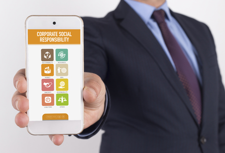 long term goal: Man showing smartphone Corporate Social Responsibility on screen Stock Photo
