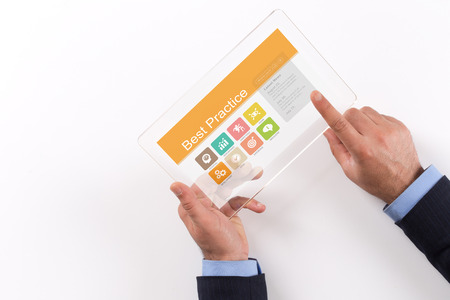 outcomes: Hand Holding Transparent Tablet PC with Best Practice screen Stock Photo