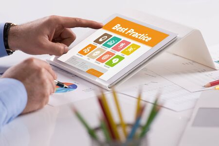 working ethic: Best Practice screen on the tablet pc Stock Photo