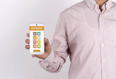 working ethic: Man showing smartphone Best Practice on screen Stock Photo