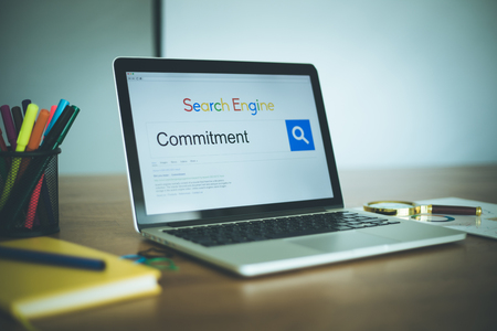 observance: Search Engine Concept: Searching COMMITMENT on Internet Stock Photo