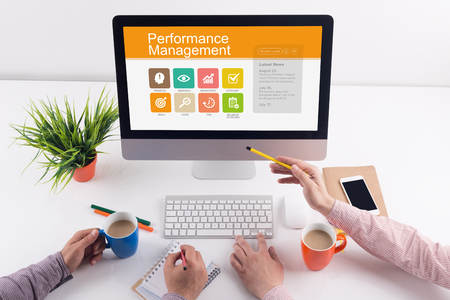 intervenes: Performance Management screen on the workplace Stock Photo