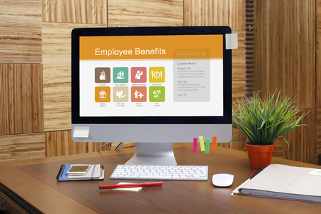pay raise: Employee Benefits text on screen Stock Photo