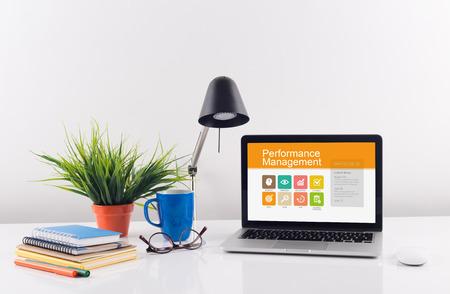 overruns: Business desk concept - Performance Management Stock Photo