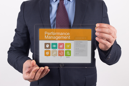 summarized: Hand Holding Transparent Tablet PC with Performance Management screen Stock Photo