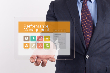 intervenes: Hand Holding Transparent Tablet PC with Performance Management screen Stock Photo