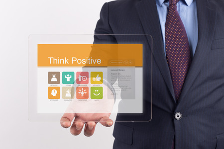 enterprising: Hand Holding Transparent Tablet PC with Think Positive screen