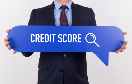 customer records: Businessman holding speech bubble with a word CREDIT SCORE