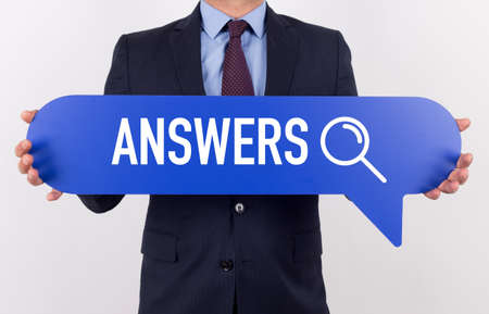 warranty questions: Businessman holding speech bubble with a word ANSWERS