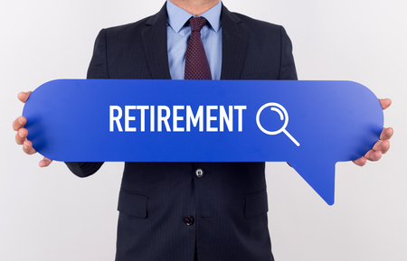 layoff: Businessman holding speech bubble with a word RETIREMENT