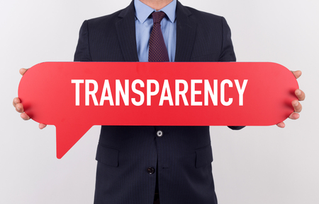 evident: Businessman holding speech bubble with a word TRANSPARENCY