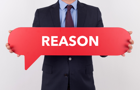 reason: Businessman holding speech bubble with a word REASON