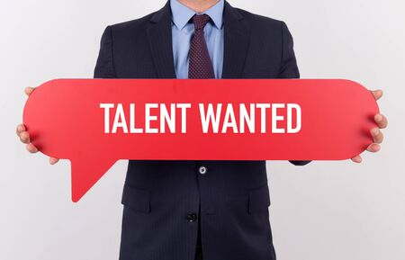 human potential: Businessman holding speech bubble with a word TALENT WANTED