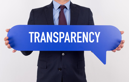 transparency: Businessman holding speech bubble with a word TRANSPARENCY
