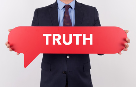 answer approve of: Businessman holding speech bubble with a word TRUTH Stock Photo