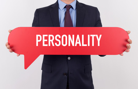 sensing: Businessman holding speech bubble with a word PERSONALITY Stock Photo