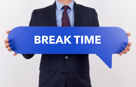 over worked: Businessman holding speech bubble with a word BREAK TIME Stock Photo