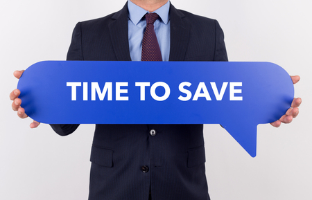 frugality: Businessman holding speech bubble with a word IF TIME TO SAVE Stock Photo