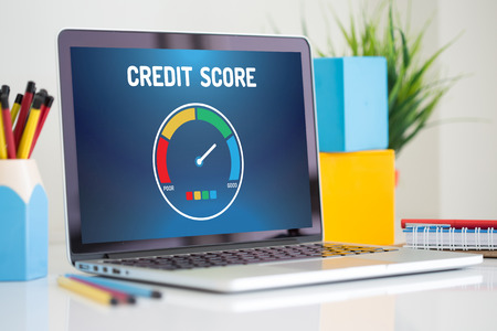 Computer with credit score application on a screen Stok Fotoğraf