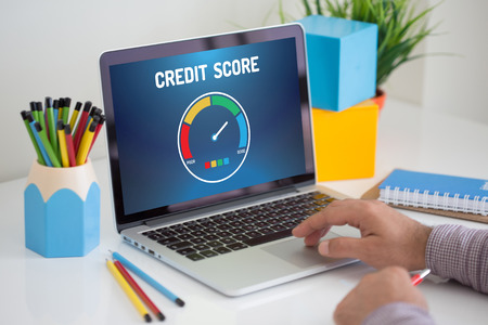 score: Computer with credit score application on a screen Stock Photo