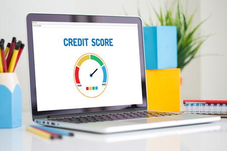 Computer with credit score application on a screen Banco de Imagens
