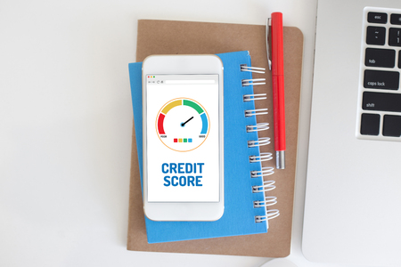 fico: Smart phone with credit score application on a screen