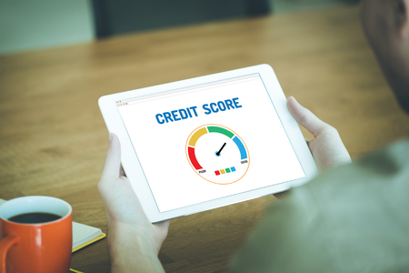 credit score: Tablet pc with credit score application on a screen Stock Photo