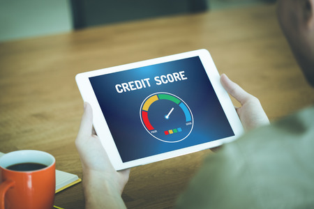 Tablet pc with credit score application on a screen Stock Photo