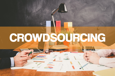 crowd source: Two Businessman Crowdsourcing working in an office