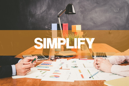 simplification: Two Businessman Simplify working in an office