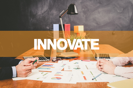 to innovate: Two Businessman Innovate working in an office