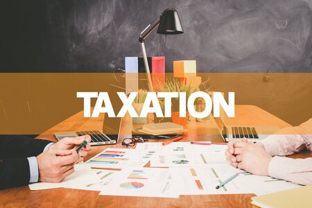 exemption: Two Businessman Taxation working in an office