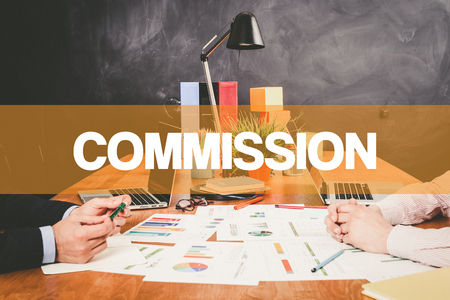 Two Businessman Commission working in an office Stock Photo