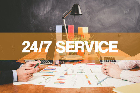 24x7: Two Businessman 247 Service working in an office