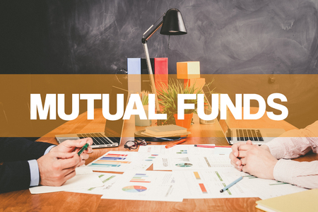 financial diversification: Two Businessman Mutual Funds working in an office