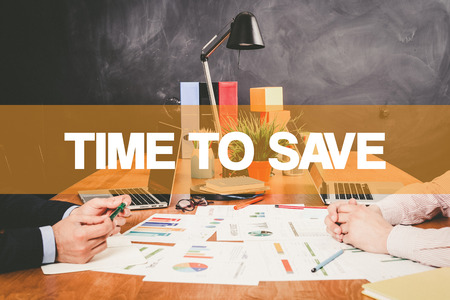 frugality: Two Businessman Time To Save working in an office
