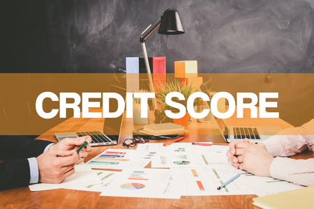 creditworthiness: Two Businessman Credit Score working in an office