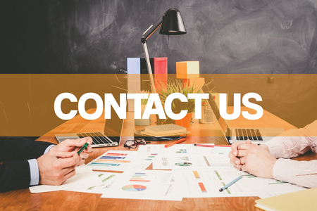 contactus: Two Businessman Contact Us working in an office