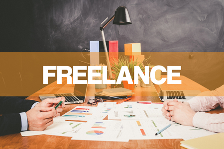 freelance: Two Businessman Freelance working in an office