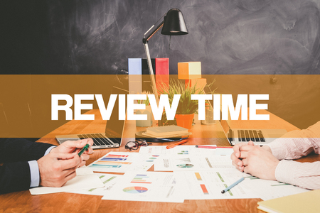 credential: Two Businessman Review Time working in an office Stock Photo